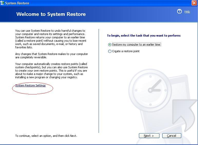 mengaktifkan system restore windows xp